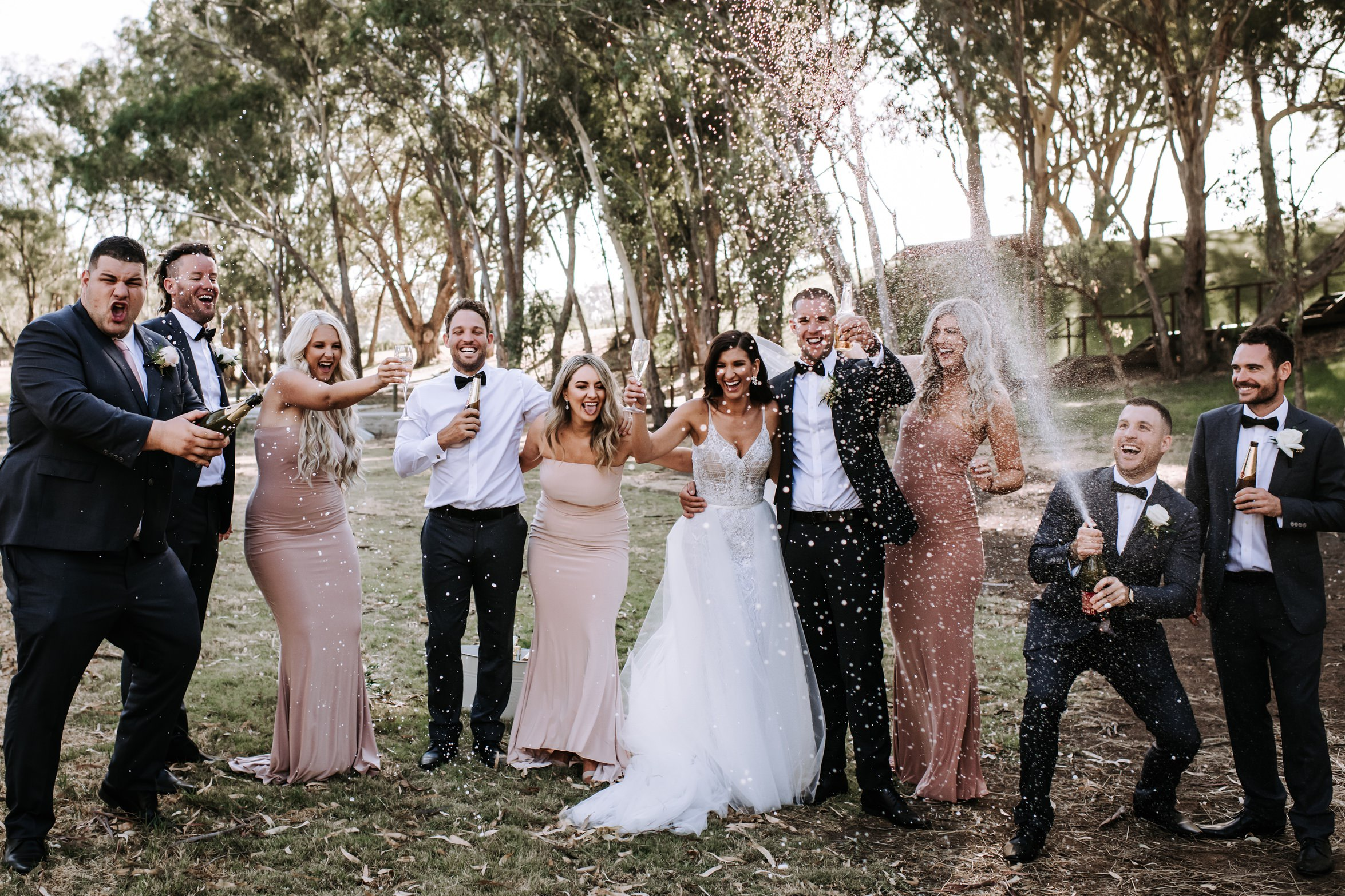 bridal party spraying champagne Mandoon Estate Perth